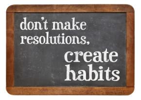 Do not make resolutions, create habits - advice on a vintage slate blackboard